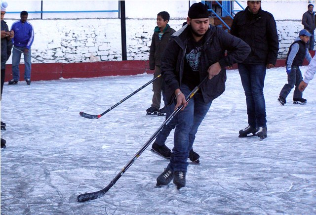 children playing ice hockey in shimla